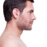 Profilstående av den stiliga unga mannen arkivfoto