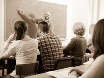 Profissionais e treinador no treinamento fotografia de stock royalty free