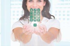Profissional fêmea com ícones médicos Fotos de Stock Royalty Free