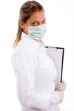 Profissional médico com almofada e máscara de escrita Fotografia de Stock Royalty Free