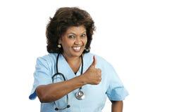 Profissional médico - polegares acima imagem de stock