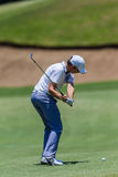 Profissional Tommy Fleetwood Swinging do golfe Fotografia de Stock