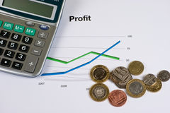 Profit. Riseing profit chart with some money Royalty Free Stock Photo