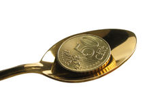 Profit. Fifty eurocent in gold spoon royalty free stock photo