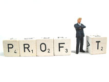 Profit. A businessman standing for the i in profit royalty free stock images