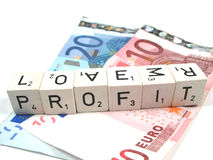 Profit. The word profit on top of some banknotes royalty free stock photography