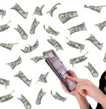 Profit. Businesswoman calculating profit over flying money Royalty Free Stock Photos