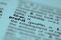 PROFIT. Extreme macro or close up of the word PROFIT. Very shallow depth of field is intentional and shows only the word profit in focus Royalty Free Stock Images