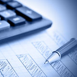 Profit bar chart. Pen and calculator. Shallow DOF! Focus on the pen Stock Photography