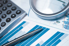 Profit bar chart, calculator and pen. Profit bar chart, pen and calculator. Shallow DOF. Focus on the pen Stock Image