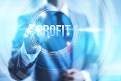 Profit business concept. Businessman pointing towards camera selecting profit text, virtual interface Stock Images
