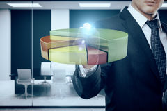 Profit concept. Businessman drawing abstract transparent business diagram in blurry meeting room interior. Profit concept. 3D Rendering royalty free stock photography