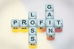 Profit, Gain and Loss on Dice Stock Image