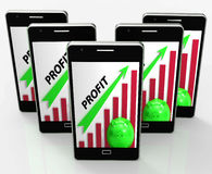 Profit Graph Phone Shows Sales Revenue And Return. Profit Graph Phone Showing Sales Revenue And Return Royalty Free Stock Photos