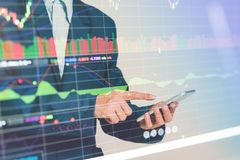 Profit graph of stock market trade indicator financial. Double exposure Businessman finger touching smart phone with finance and banking profit graph of stock Stock Photography