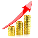 Profit growth graph up on the a stack of coins Stock Image