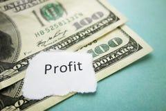Profit headline. Profit newspaper headline on hundred dollar bills Stock Image