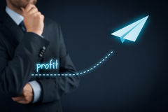 Profit improvement. Increase profit concept. Businessman plan profit acceleration and growth represented by graph and paper plane Stock Photo