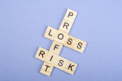 Profit, loss and risk crossword blocks on table. Top view Royalty Free Stock Photography