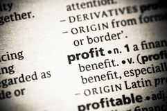 Profit. Macro view of the word profit Royalty Free Stock Photo