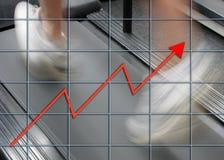 Profit man. Man running on treadmill overlaid with graph Stock Image