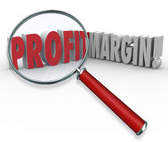 Profit Margins Magnifying Glass Words Big Earnings. Profit Margins words under a magnifying glass to illustrate a search for big earnings and growing your income Royalty Free Stock Photo