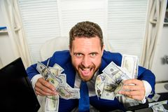 Profit and richness concept. Businessman formal suit hold cash dollars hands. Che k out my profit this month. Earn money. Easy business tips. Man cheerful happy stock photo