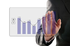 Profit rises. Businessman looks at the development of the profit in a chart Royalty Free Stock Images