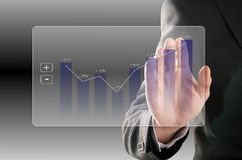 Profit rises. Businessman looks at the development of the profit in a chart Stock Images