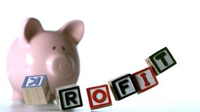 Profit spelled out in block letters dropping down Royalty Free Stock Photo