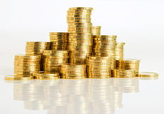 Profit. A stack of coins of the yellow metal close-up Royalty Free Stock Photo
