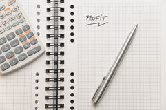 Profit written on white spiral notebook Royalty Free Stock Photos