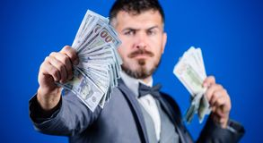 A profitable business. Bearded man holding cash money. Making money with his own business. Currency broker with bundle. Of money. Rich businessman with us stock photos