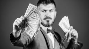 A profitable business. Bearded man holding cash money. Making money with his own business. Currency broker with bundle. Of money. Rich businessman with us royalty free stock image