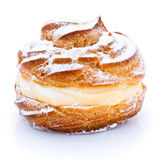 Profiterole. Or cream puff with filling and powdered sugar topping, isolated on white background stock image