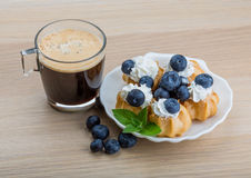 Profiterole with blueberry Stock Photos