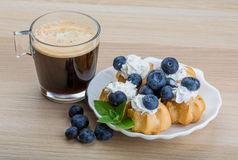 Profiterole with blueberry Royalty Free Stock Images