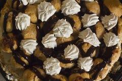Profiterole cake. Delicious Profiterole cake with whipped cream Royalty Free Stock Images
