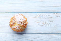 Profiterole with cream. Homemade profiterole with cream on white wooden table Stock Photos