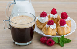Profiterole with raspberry Royalty Free Stock Image