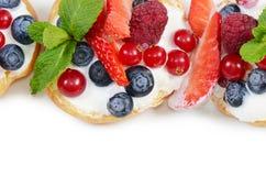 Profiteroles with berries currant Stock Photo