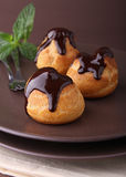 Profiteroles with chocolate Royalty Free Stock Photo
