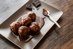 Profiteroles with chocolate cream. Royalty Free Stock Images