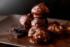 Profiteroles with chocolate cream. Royalty Free Stock Photography