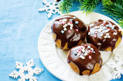 Profiteroles with chocolate icing and colored powder Royalty Free Stock Image