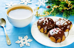 Profiteroles with chocolate icing and colored powder Stock Image