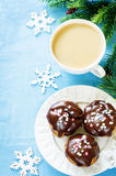Profiteroles with chocolate icing and colored powder and coffee Stock Photo