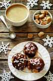 Profiteroles with chocolate icing and colored powder and coffee Stock Images
