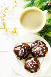 Profiteroles with chocolate icing and colored powder and coffee Stock Photos