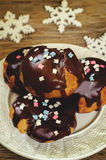 Profiteroles with chocolate icing and colored powder Royalty Free Stock Photos